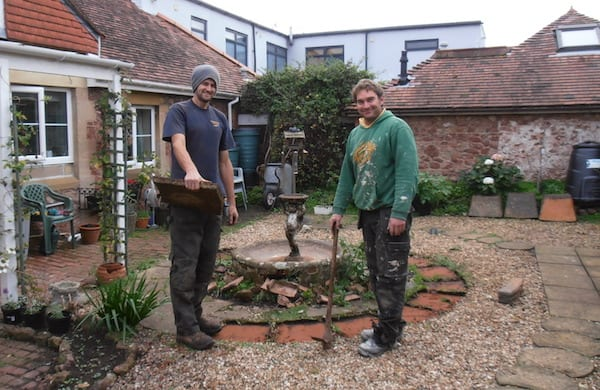 The cornerstone team working on a garden